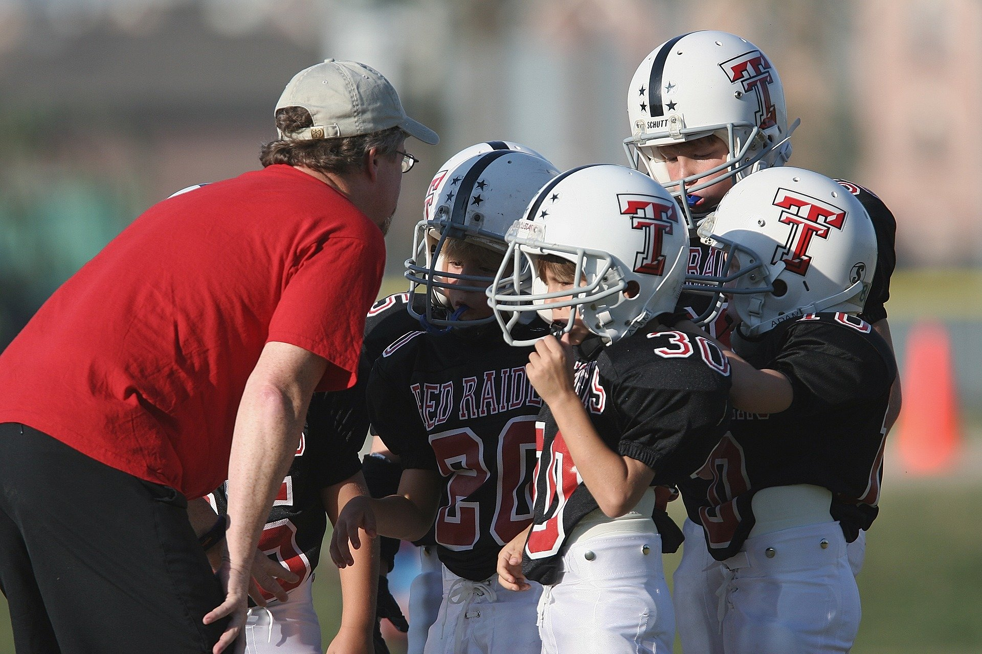 Researchers suggest ways to reduce head impacts in youth football